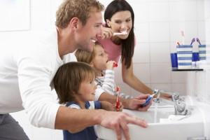 Dentist in Carson City - Family In Bathroom Brushing Teeth - DentistCarsonCity.com